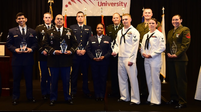 Award winners stand together May 13, 2016, after the Armed Forces Recognition Luncheon at the Doubletree Stapleton Hotel in Denver. The Aurora Chamber of Commerce along with local businesses hosts the annual lunch to recognize and honor the growing number of active duty, guard and reserve Service members throughout the area. (U.S. Air Force photo by Airman 1st Class Gabrielle Spradling/Released)
