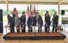 David Williams, Chip Marin, Maj. Gen. Ted Harrison, Bill Kelly, Richard Kidd, Col. Bill Marks and Michael McGhee symbolically break ground on Redstone Arsenal's solar project June 3.