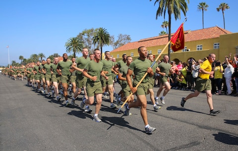 Marines of Fox Company, 2nd Recruit Training Battalion, run in formation during their motivation run at Marine Corps Recruit Depot San Diego, June 2. The run signifies the last training event on the training schedule. Annually, more than 17,000 males recruited from the Western Recruiting Region are trained at MCRD San Diego. Fox Company is scheduled to graduate June 3.