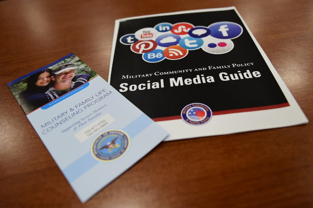 Social media and Military and Family Life Counseling Program pamphlets sit on the welcome table May 19, 2016, before a Heart Apart event on Buckley Air Force Base, Colo. The goal of the event was to provide support to military spouses and families, along with providing them information about services available on base. (U.S. Air Force photo by Airman 1st Class Gabrielle Spradling/Released)