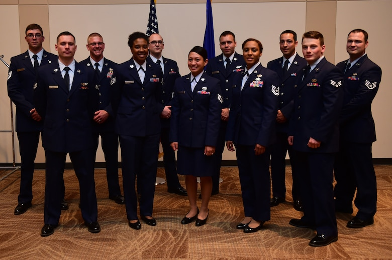 Newly promoted Airmen stand together May 31, 2016, after the May promotion ceremony at the Leadership Development Center on Buckley Air Force Base, Colo. Promotion ceremonies are a time-honored tradition in the Air Force, allowing co-workers, family and friends to support and congratulate Airmen on their new rank. (U.S. Air Force photo by Airman 1st Class Gabrielle Spradling/Released)
