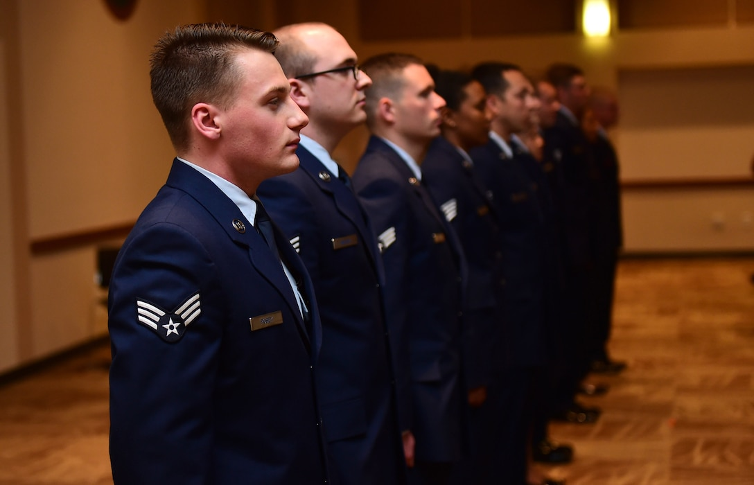 Newly promoted Airmen lead the audience in the Airmen's Creed May 31, 2016, during the May promotion ceremony at the Leadership Development Center on Buckley Air Force Base, Colo. The Airmen's Creed is a statement fueled by the Air Force's heritage and warfighting ethos, which was introduced in April 2007. (U.S. Air Force photo by Airman 1st Class Gabrielle Spradling/Released)