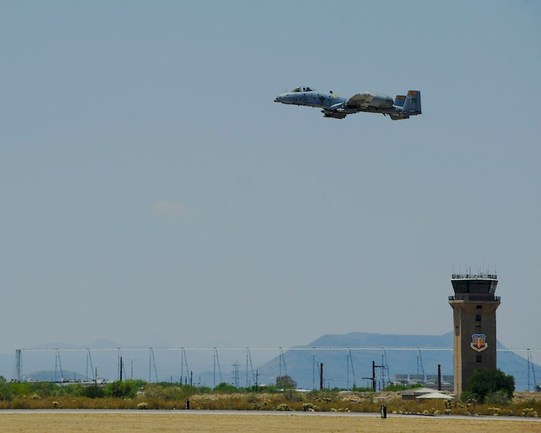 An A-10C Thunderbolt II from the 357th Fighter Squadron flies over the flight line during Hawgsmoke 2016 at Davis-Monthan Air Force Base, Ariz., June 1, 2016. D-M hosted this year's biennial competition comprised of nearly 50 A-10s from across the country. (U.S. Air Force photo by Airman 1st Class Ashley N. Steffen/Released)