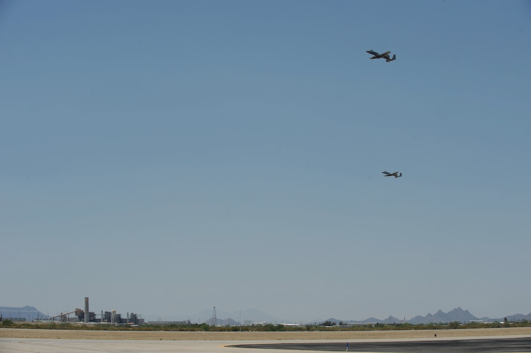 Two A-10C Thunderbolt IIs fly over the flight line during Hawgsmoke 2016 at Davis-Monthan Air Force Base, Ariz., June 1, 2016. D-M hosted the biennial competition which scores strafing accuracy, high-altitude dive-bombing, low-angle high-delivery, Maverick missile precision and team tactics. (U.S. Air Force photo by Airman 1st Class Ashley N. Steffen/Released)