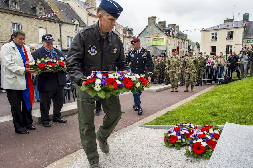 Air Force Lt. Gen. Timothy Ray lays a ceremonial wreath at the Airborne Troops Monument in Sainte Mere Eglise, France.