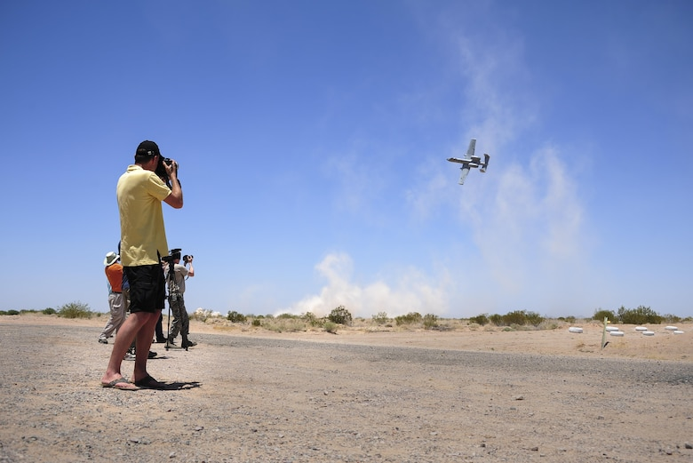 Members of local and international media photograph an A-10C Thunderbolt II during the 2016 Hawgsmoke competition at Barry M. Goldwater Range, Ariz., June 2, 2016. Thirteen A-10 units worldwide participated in this year's competition. (U.S. Air Force photo by Senior Airman Chris Drzazgowski/Released)