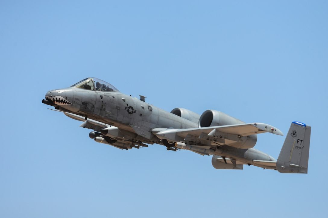 An A-10C Thunderbolt II assigned to the 23rd Fighter Group, Moody AFB, Ga., performs a flying maneuver during the 2016 Hawgsmoke competition at Barry M. Goldwater Range, Ariz., June 2, 2016. The first Hawgsmoke competition began in 2002 where A-10 units across the globe competed in ground attacks and target destruction. (U.S. Air Force photo by Airman 1st Class Mya M. Crosby/Released)
