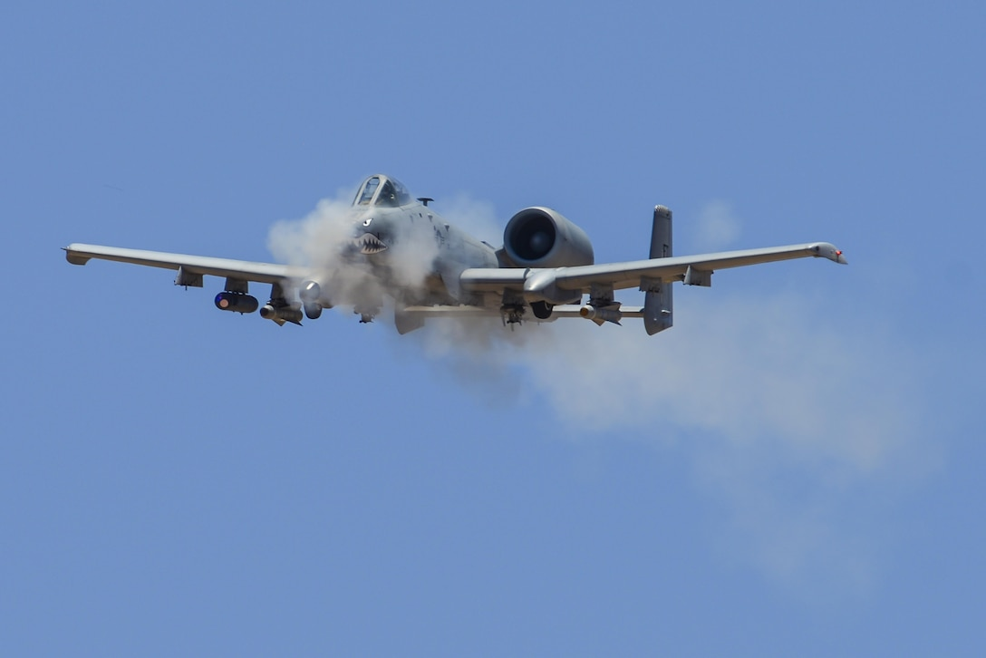 An A-10C Thunderbolt II assigned to the 23rd Fighter Group, Moody AFB, Ga., performs a low-angle strafe during the 2016 Hawgsmoke competition at Barry M. Goldwater Range, Ariz., June 2, 2016. Hawgsmoke is a biennial competition focused on tactics the A-10C can employ during combat operations. (U.S. Air Force photo by Senior Airman Chris Drzazgowski/Released)