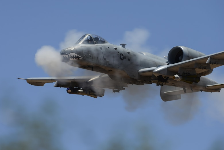 An A-10C Thunderbolt II assigned to the 75th Fighter Squadron performs a low-angle strafe during the 2016 Hawgsmoke competition at Barry M. Goldwater Range, Ariz., June 2, 2016. Hawgsmoke took place over the course of two days and included individual and team scoring of strafing, high-altitude dive-bombing, Maverick missile precision and team tactics. (U.S. Air Force photo by Senior Airman Chris Drzazgowski/Released)