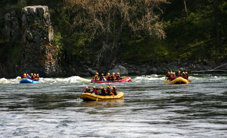 Fairchild Air Force Base Airmen raft down the Spokane River, during a Base Chapel resilience trip April 16, 2016, Spokane, Wash. The trip gave Airmen an opportunity to focus on resilience and the five wellness pillars; social, spiritual, physical, and mental. The chapel hosts different trips during the year to include: white water rafting, zip lining and rock climbing. (Courtesy Photo)