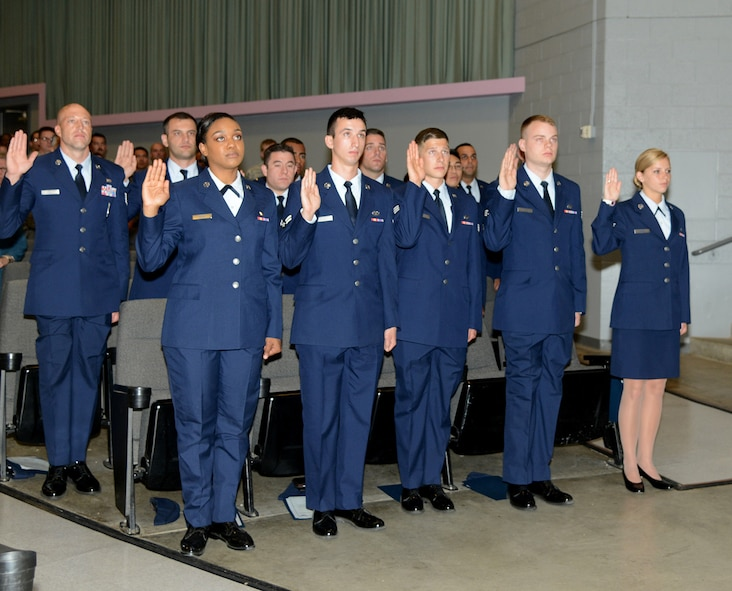 Airmen recite the oath of enlistment during a promotion ceremony here. Ceremony was performed by Secretary of the Air Force Deborah Lee James during her visit to Edwards Wednesday. (U.S. Air Force photo by Christopher Ball.)