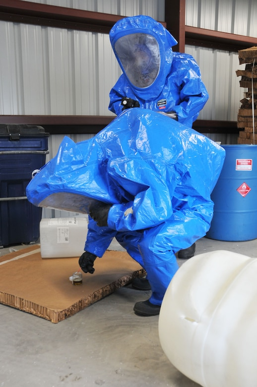 Tech. Sgt. Lee Dresch tests a sample of a simulated hazardous material spill during a Hazardous Waste Operations and Emergency Response (HAZWOPER) class at the 120th Airlift Wing in Great Falls Mont. May 20, 2016. The 120th AW offers an annual 40 hour course and an 8 hour refresher course annually. (U.S. Air National Guard photo/Senior Master Sgt. Eric Peterson)