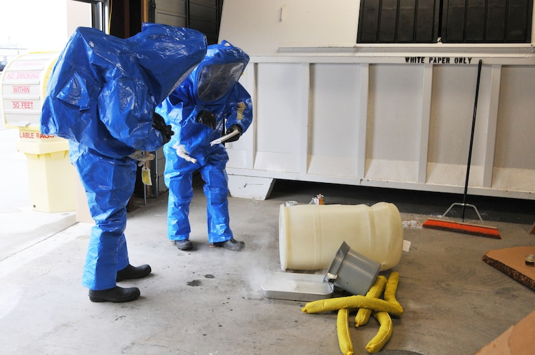 120th Airlift Wing Tech Sgt. Lee Dresch reads information found on chemical containers to Tech. Sgt. Dale Vig at a simulated hazardous material spill during a Hazardous Waste Operations and Emergency Response (HAZWOPER) class held at the 120th Airlift Wing in Great Falls Mont. May 20, 2016. The 120th AW offers a 40 hour course and 8 hour refresher course annually. (U.S. Air National Guard photo/Senior Master Sgt. Eric Peterson)