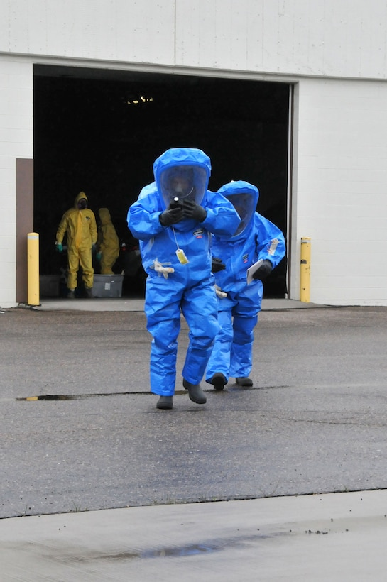 120th Airlift Wing members Tech. Sgt. Lee Dresch and Tech. Sgt. Dale Vig walk to a facility containing a simulated hazardous material spill during a Hazardous Waste Operations and Emergency Response (HAZWOPER) class held at the 120th Airlift Wing in Great Falls Mont. May 20, 2016. The 120th AW offers a 40 hour course and 8 hour refresher course annually. (U.S. Air National Guard photo/Senior Master Sgt. Eric Peterson)