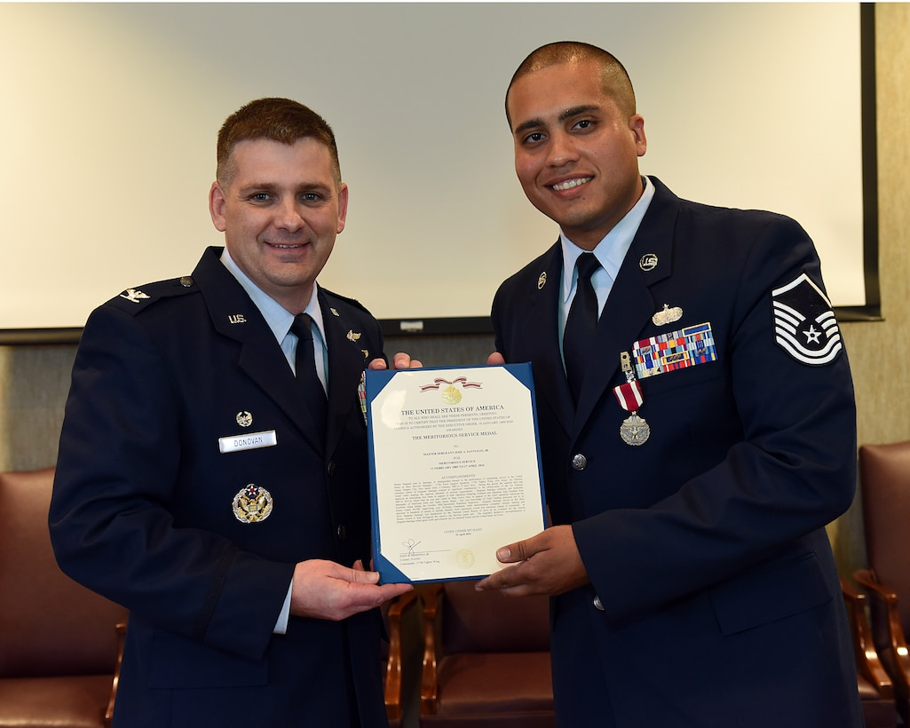 Master Sgt. Jose A. Santiago Jr. is presented the Meritorious Service Medal, June 2, 2016, at the I.G. Brown Training and Education Center in Louisville, Tenn., by Col. Kevin Donovan, commander, during a commander's call. (U.S. Air National Guard photo by Master Sgt. Mike R. Smith/Released)