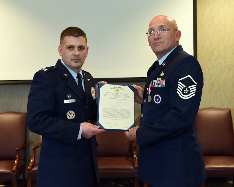 Master Sgt. Don Pierson is awarded the Meritorious Service Medal, June 2, 2016, at the I.G. Brown Training and Education Center in Louisville, Tenn., by Col. Kevin Donovan, commander, during a commander's call. (U.S. Air National Guard photo by Master Sgt. Mike R. Smith/Released)
