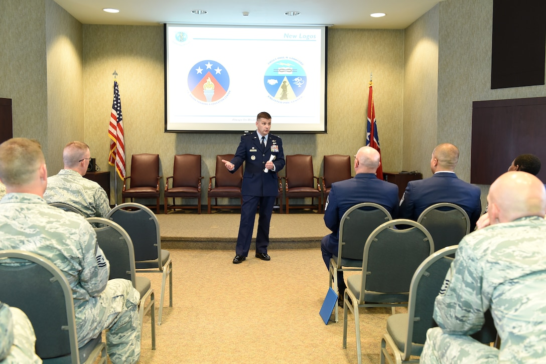 Col. Kevin Donovan, commander, I.G. Brown Training and Education Center in Louisville, Tenn., speaks with his staff about the center's revised official logos, among other topics discussed, June 2, 2016, during a commander's call. About 50 Airmen gathered in the Wingman Hall building. The center holds commander's calls quarterly.(U.S. Air National Guard photo by Master Sgt. Mike R. Smith/Released)