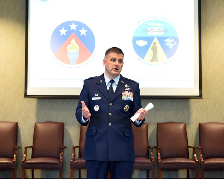 Col. Kevin Donovan, commander, I.G. Brown Training and Education Center in Louisville, Tenn., speaks with his staff about the center's revised official logos, among other topics discussed, June 2, 2016, during a commander's call. (U.S. Air National Guard photo by Master Sgt. Mike R. Smith/Released)