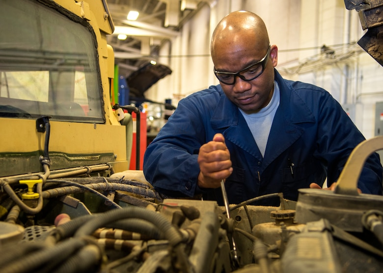 Tech. Sgt. Mortimer Jacobs, 90th Logistics Readiness Squadron Multi-Purpose Vehicle Maintenance Shop NCOIC, inspects a Humvee May 4, 2016 in a LRS building on F.E. Warren Air Force Base, Wyo. Jacobs reviews each vehicle that is sent through the shop and works to streamline the maintenance process while ensuring safe, secure and effective operations. (U.S. Air Force photo by Airman 1st Class Malcolm Mayfield)