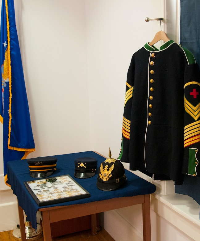 Examples of uniform items worn by Buffalo Soldiers, including a medical soldier's uniform top, various covers and a framed case of pins and devices, sit on display in the Warren ICBM & Heritage Museum on F.E. Warren Air Force Base, Wyo., June 1, 2016. The base spent more time as an Army post than it has an Air Force base, and during its history included a Buffalo Soldier units. (U.S. Air Force photo by Senior Airman Jason Wiese)
