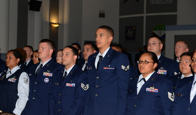 Community College of the Air Force graduates stand while being pronounced graduates at their graduation ceremony June 3, 2016 at Joint Base Lewis-McChord, Wash. More than 150 Team McChord Airmen earned CCAF Associate of Arts degrees. (U.S. Air Force photo/Senior Airman Jacob Jimenez)