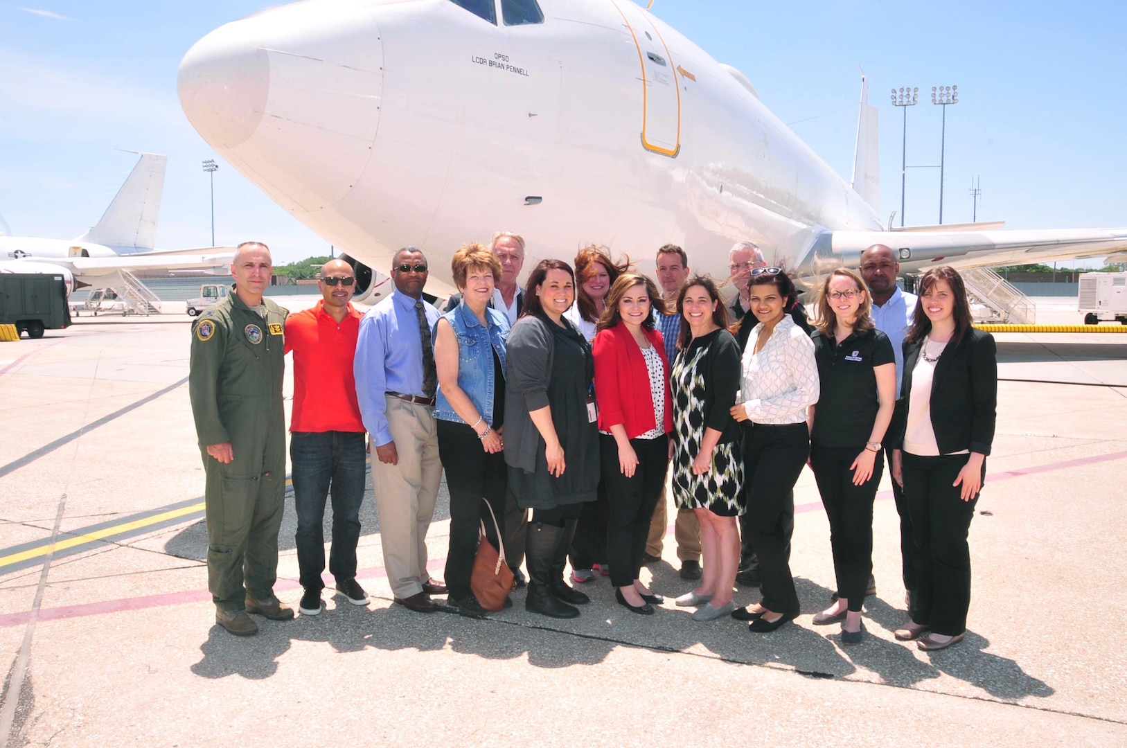 U.S. Air Force Col. Lloyd Buzzell, U.S. Strategic Command (USSTRATCOM) global watch division chief (left), poses for a photo with University of Nebraska Omaha (UNO) Executive Master of Business Administration (EMBA) program participants, alumni and leaders in front of an E-6B Airborne Command Post (ABNCP) aircraft at Offutt Air Force Base, Neb., June 3, 2016. While here, the visiting group toured USSTRATCOM's global operations center and the E-6B ABNCP aircraft, and received a command mission briefing from U.S. Air Force Maj. Gen. Richard J. Evans III, mobilization assistant to the USSTRATCOM deputy commander (not pictured). One of nine DoD unified combatant commands, USSTRATCOM has global strategic missions, assigned through the Unified Command Plan, which include strategic deterrence; space operations; cyberspace operations; joint electronic warfare; global strike; missile defense; intelligence, surveillance and reconnaissance; combating weapons of mass destruction; and analysis and targeting. (Courtesy photo)