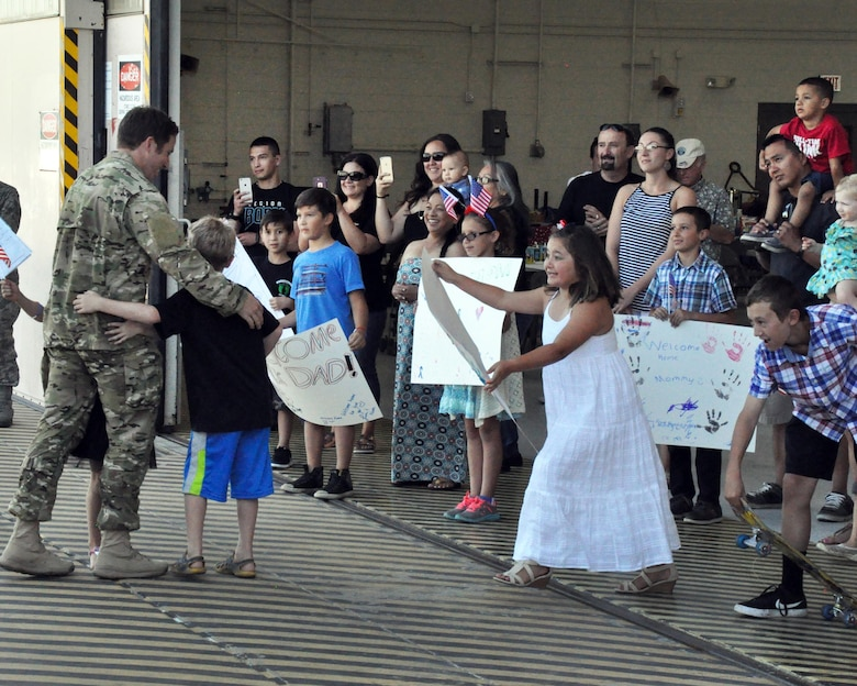 Families greet their loved ones upon the return of the 306th Rescue Squadron to Davis-Monthan Air Force Base, Ariz., from the Horn of Africa June 2. The 306th RQS is part of the 943rd Rescue Group, the Air Force Reserve Command's premier combat search and rescue group. They were deployed for four months and saved six lives during the deployment, flew more than 500 combat hours, conducted 67 parachute deployments, and provided more than 2,600 hours of dedicated alert coverage. (U.S. Air Force photo/Master Sgt. Greg Gaunt)