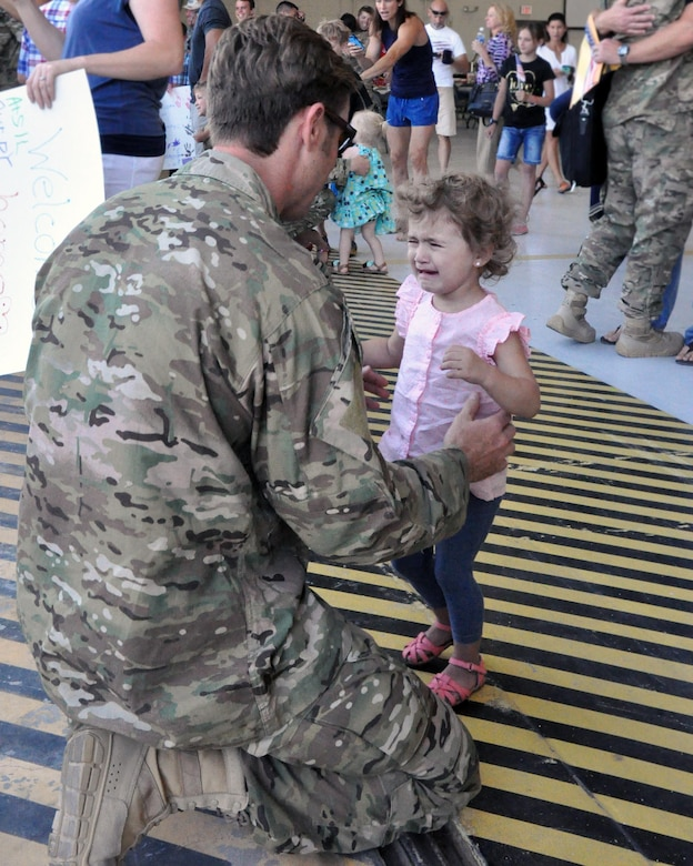 A little girl cannot contain her joy to see her father as he returns to Davis-Monthan Air Force Base June 2 from a 306th Rescue Squadron deployment to the Horn of Africa.  The 306th RQS is part of the 943rd Rescue Group, the Air Force Reserve Command's premier combat search and rescue group. As citizen Airmen, most of the men and women of the reserve rescue group here balance the unique requirements of a civilian career, a military career, and family. (U.S. Air Force photo/Master Sgt. Greg Gaunt)