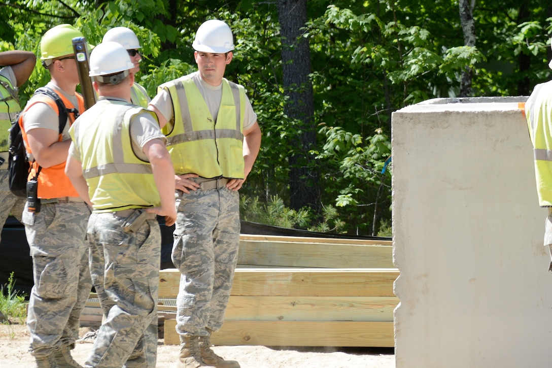 U.S. Air Force Staff Sgt. Elijah Hall, a pavements and construction equipment specialist assigned to the 139th Civil Engineer Squadron, Missouri Air National Guard, participates in an Innovative Readiness Training (IRT) operation, at William Hinds Boy Scout Camp in Raymond, Maine, on June 1, 2016. The IRT is part of a joint operation with the U.S. Marines, Navy, Air National Guard, and Air Force Reserve to help rebuild parts of the camp. (U.S. Air National Guard photo by Tech. Sgt. Theo Ramsey/Released)