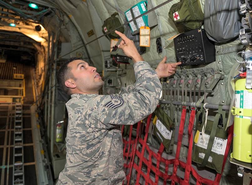 U.S. Air Force Tech. Sgt. Jose A. Ruiz, a crew chief cross-training to become a C-130 flight engineer with the 169th Airlift Squadron, Illinois Air National Guard, demonstrates the different settings of jump lights on a C-130 Hercules aircraft in Peoria, Ill., April 30, 2016. Ruiz, a first-generation American with Mexican heritage, said a good thing about diversity in the military is that it allows everyone to experience the differences between cultures and backgrounds. (U.S. Air National Guard photo by Staff Sgt. Lealan Buehrer)