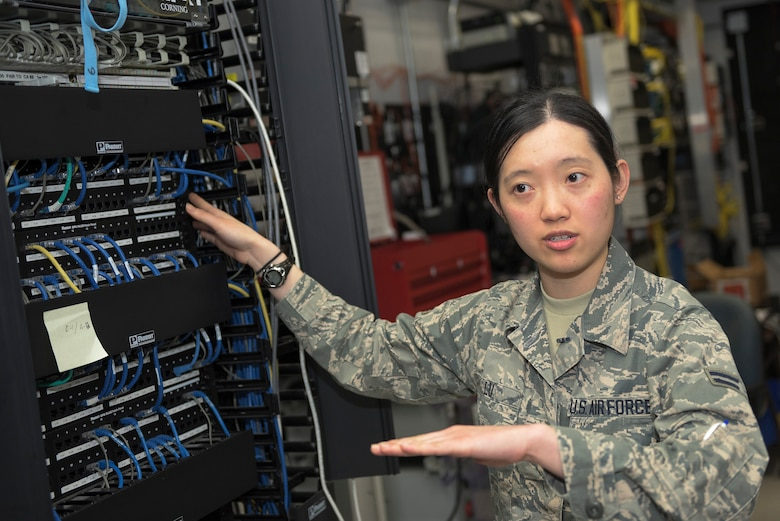 U.S. Air Force Airman 1st Class Irene Lu, a cyber transport systems specialist with the 182nd Communications Flight, Illinois Air National Guard, explains how a network patch panel operates in Peoria, Ill., April 30, 2016. Lu, a first-generation American of Chinese heritage and the only female in her shop, said that the more diversity the military has, the more one person can learn about the world and learn from different experiences. (U.S. Air National Guard photo by Staff Sgt. Lealan Buehrer)