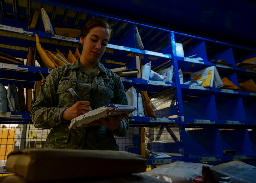 Airman 1st Class Jillian Koontz, 51st Communications Squadron postal clerk, enters packages into a tracking system before being sorted for final delivery at Osan Air Base, Republic of Korea, June 3, 2016. Each package is individually tracked and processed to ensure quick and proper delivery. (U.S. Air Force photo by Senior Airman Victor J. Caputo/Released)