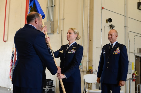 U.S. Air Force Lt. Col. Bryony A. Terrell (center) assumes command of the 139th Mission Support Group during a change of command ceremony at Rosecrans National Guard Base, St. Joseph, Mo., June 4, 2016. The outgoing group commander, Col. Gordon Meyer (right), has been selected to attend the U.S. Air Force Air War College at Maxwell Air Force Base, Ala. (U.S. Air National Guard photo by Tech. Sgt. Michael Crane/released)