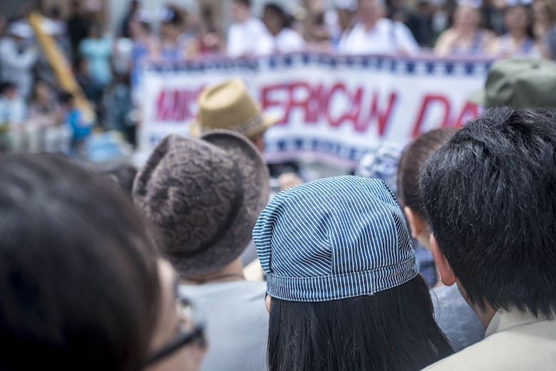 Japanese and Americans line the street, shoulder-to-shoulder, watching as the 28th Annual American Day parade banner marches past in Misawa City, Japan, June 5, 2016. Events like these are important as they afford Misawa neighbors, American and Japanese alike, opportunities to interact in a relaxed environment specifically planned for building friendships. More than 80,000 attendees from across the Aomori Prefecture traveled to Misawa City to enjoy American and Japanese culture. (U.S. Air Force photo by Staff Sgt. Benjamin W. Stratton)