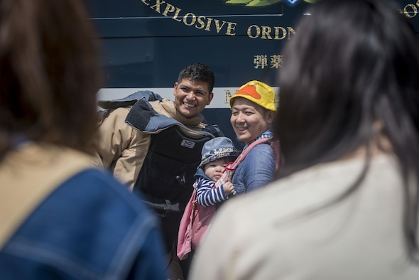 U.S. Air Force Senior Airman Manuel Carvajal, an explosive ordnance disposal journeyman with the 35th Civil Engineer Squadron, smiles as he poses for a photo in his bomb suit with Japanese residents from across the Aomori Prefecture during the 28th Annual American Day in Misawa City, Japan, June 5, 2016. In a showcase of the region's bilateral partnership among U.S. military and Japanese citizens, more than 80,000 attendees enjoyed live performances, including Sublime with Rome, indulging in American and Japanese cuisine and strengthening international bonds. Carvajal is a Lorraine, Texas, native. (U.S. Air Force photo by Staff Sgt. Benjamin W. Stratton)