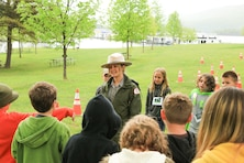 Park Ranger Alicia Palmer, Baltimore District, speaks to fourth-grade students from Southern Huntingdon School District during their visit to Raystown Lake in part of the White House's Every Kid in a Park youth initiative, May 10-11, 2016.  