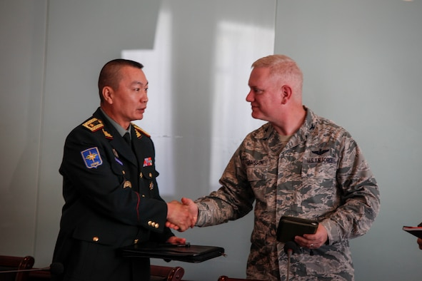 Mongolian Armed Forces Brig. Gen. D.Ganzorig, left, U.S. Air Force Col. Carl Magnusson, center, exercise co-director for Khaan Quest 16 and U.S. Marine Corps Maj. Robert Shuford, answer questions about the exercise at a media engagement at the Ministry of Defense, in Ulaanbatar, Mongolia, May 20, 2016. Khaan Quest is an annual, multinational peacekeeping operations exercise conducted in Mongolia and is the capstone exercise for this year's United Nations Global Peace Operations Initiative program. (U.S. Marine Corps photo by Cpl. Hilda M. Becerra / Released)