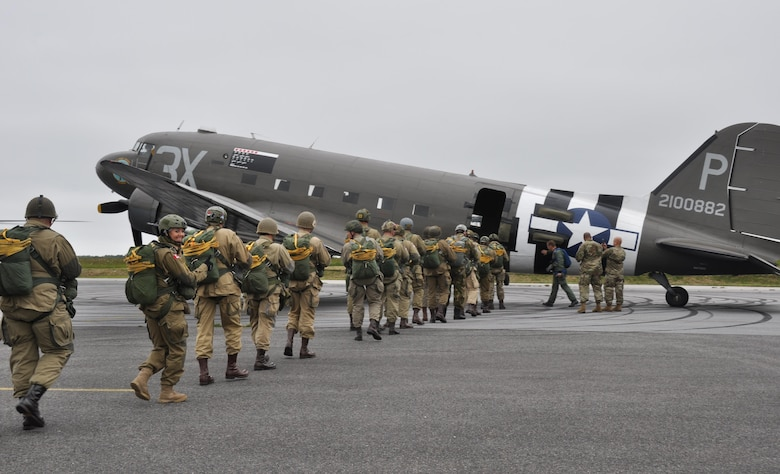 Father and daughter Liberty Jump Team members, Tom Lupu and Yvanna Sworobowicz, along with other team members board a C-47 for an exhibition jump into Graignes, France June 3, 2016 for the D-Day commemoration. More than 380 service members from Europe and affiliated D-Day historical units are participating in the 72nd anniversary as a part of Joint Task Force D-Day 72.  The Task Force,  based in Sainte-Mère-Église, France, is supporting local events across Normandy, from May 30 - 6 June, 2016 to commemorate the selfless actions by all of the allies on D-Day that continue to resonate 72 years later.  (U.S. Air Force photo by Master Sgt. Jessica L. Kendziorek)
