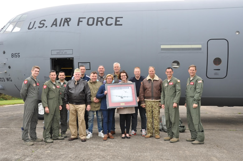 Members of one of the D-Day historical re-enactor groups recieved a tour of the C-130J and a framed print from the 815th Airlift Squadron on June 3, 2016.  More than 380 service members from Europe and affiliated D-Day historical units are participating in the 72nd anniversary as a part of Joint Task Force D-Day 72.  The Task Force,  based in Sainte-Mère-Église, France, is supporting local events across Normandy, from May 30 - 6 June, 2016 to commemorate the selfless actions by all of the allies on D-Day that continue to resonate 72 years later.  (U.S. Air Force photo by Master Sgt. Jessica L. Kendziorek)