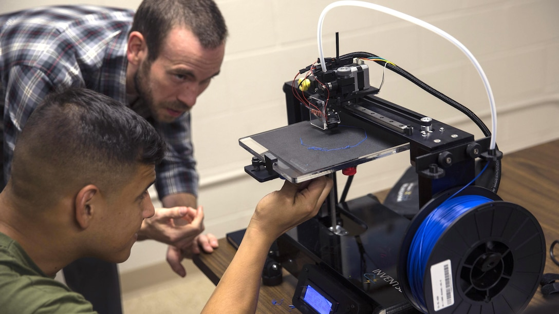 Justin Yates, an assistant professor at Francis Marion University, teaches the Marines about the capabilities of a 3D printer at Marine Corps Base Camp Lejeune, North Carolina, June 2, 2016. Additive manufacturing, or 3D printing, allows Marines to produce parts quickly, with exact specifications and at almost any location.