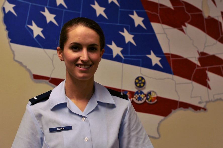 U.S. Air Force 1st Lt. Cassandra Dunn, 315th Training Squadron student, stands next to a decorated U.S. sign in Brandenburg Hall on Goodfellow Air Force Base, Texas, June 3, 2016. Dunn is the Goodfellow Student of the Month Spotlight for May, a series highlighting Team Goodfellow students. (U.S. Air Force photo by Airman 1st Class Caelynn Ferguson/Released)