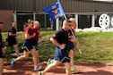 Members of the 39th Aerial Port Squadron run the annual Port Dawg Memorial Run, May 14, 2016 at Peterson Air Force Base, Colo. The 39th APS ran to pay tribute to transportation and logistics Reservists and to commemorate those currently serving, those who previously served and all fallen Port Dawg brothers and sisters. (U.S. Air Force photo/Staff Sgt. Amber Sorsek)