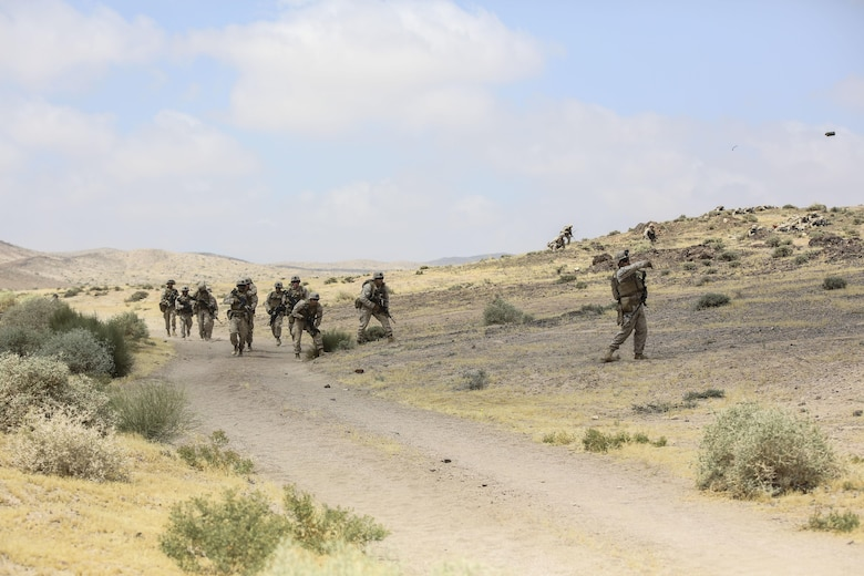 Marines with 1st Battalion, 2nd Marine Regiment, 2nd Marine Division advance down range during the Eager Lion 16 final exercise in Al Quweyrah, Jordan, May 24, 2016. Eager Lion is a recurring exercise between partner nations designed to strengthen military-to-military relationships, increase interoperability, and enhance regional security and stability. (U.S. Marine Corps photo by Cpl. Paul S. Martinez/Released)