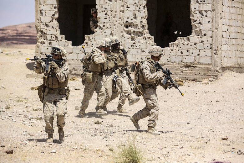 Marines with 1st Battalion, 2nd Marine Regiment, 2nd Marine Division evacuate a simulated casualty during the Eager Lion 16 final exercise in Al Quweyrah, Jordan, May 24, 2016. Eager Lion is a recurring exercise between partner nations designed to strengthen military-to-military relationships, increase interoperability, and enhance regional security and stability. (U.S. Marine Corps photo by Cpl. Paul S. Martinez/Released)
