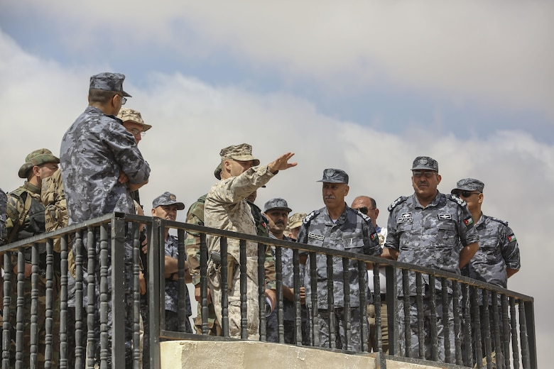 Lieutenant Col. Eric Reid, center, commanding officer of 1st Battalion, 2nd Marine Regiment, 2nd Marine Division, explains the scheme of maneuver to Royal Jordanian Navy officers during the final exercise of Eager Lion 16 in Al Quweyrah, Jordan, May 24, 2016. Eager Lion is a recurring exercise between partner nations designed to strengthen military-to-military relationships, increase interoperability, and enhance regional security and stability. (U.S. Marine Corps photo by Cpl. Paul S. Martinez/Released)