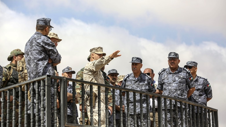 Lt. Col. Eric Reid, center, commanding officer of 1st Battalion, 2nd Marine Regiment, 2nd Marine Division, explains the scheme of maneuver to Royal Jordanian Navy officers during the final exercise of Eager Lion 16 in Al Quweyrah, Jordan, May 24, 2016. Eager Lion is a recurring exercise between partner nations designed to strengthen military-to-military relationships, increase interoperability, and enhance regional security and stability.