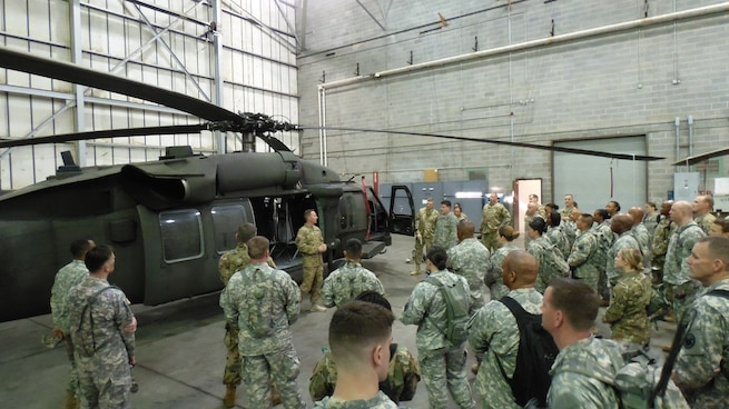 Army Reserve Capt. Richard Nezat, commander of A Company 1st Battalion, 169th Aviation Regiment gives a pre-flight briefing on the UH-60 Black Hawk helicopter to soldiers assigned to the U.S. Army Reserve Command Augmentation Unit (UAU) prior to their land navigation and orienteering exercise during their Battle Assembly on June 4, 2016, at Fort Bragg, N.C.  After the movement, Soldiers navigated to fixed points using a compass, map and protractor. The mission of the UAU is to augment United States Army Reserve Command staff during exercises, crisis actions or a presidential selective reserve call-up. Soldiers assigned to the UAU train regularly to provide the most qualified, trained and prepared Soldiers upon request by Army units. (U.S. Army photo by Lt. Col. Kristian Sorensen/released)
