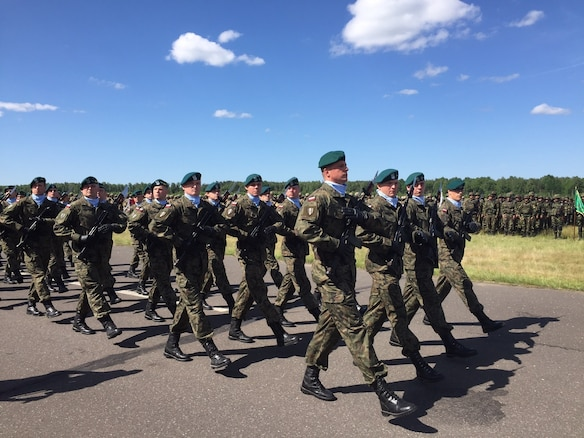 Polish Army soldiers march in review during an opening ceremony for Exercise Anakonda 2016 at the Drawsko Pomorskie Training Area, Poland, June 6. Exercise Anakonda 2016 is a Polish-led, joint multinational exercise taking place throughout Poland June 7-17. The exercise involves approximately 31,000 participants from more than 20 nations. Exercise Anakonda 2016 is a premier training event for U.S. Army Europe and participating nations and demonstrates the United States and partner nations can effectively unite under a unified command while training on a contemporary scenario. (U.S. Army photo by Timothy L. Hale) (Released)