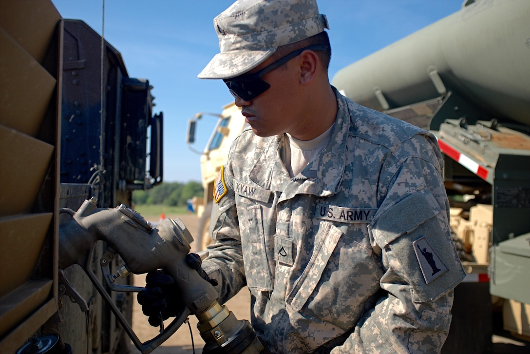 Pfc. Aung Kyaw, a petroleum supply specialist with the U.S. Army Reserve's 716th Quartermaster Company, Jersey City, N.J., fuels a Humvee at the fuel farm during Exercise Anakonda 16 at the Drawsko Pomorskie Training Area, Poland, June 4, 2016. Anakonda 16 is a Polish-led, joint multinational exercise taking place throughout Poland June 7-17. The 716th is the first U.S. Army Reserve unit to operate a fuel farm in Poland. The exercise involves more than 25,000 participants from more than 20 nations. Anakonda 16 is a premier training event for U.S. Army Europe and participating nations and demonstrates the United States and partner nations can effectively unite under a unified command while training on contemporary scenario. (U.S. Army photo by Timothy L. Hale) (Released)