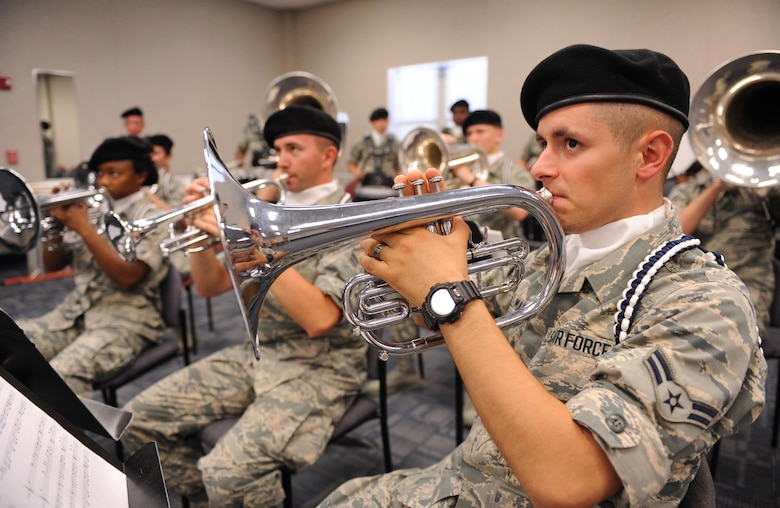 Airman 1st Class John Willman, 81st Training Wing Drum and Bugle Corps mellophone player, plays a musical piece during a practice session at the Levitow Training Support Facility May 31, 2016, Keesler Air Force Base, Miss. The drum and bugle corps performs at various events such as 81st Training Group student parades and drill downs in addition to attending Air Force specialty code technical training on a daily basis. (U.S. Air Force photo by Kemberly Groue)